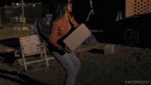 Woman throws cinder block (2)