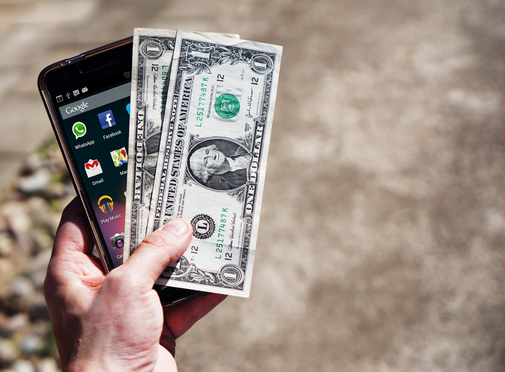 mobile-phone-money-banknotes-us-dollars-163069.jpeg